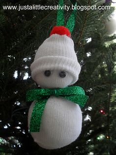 Snowman ornament made from baby socks.  Would be cute with button eyes, a felt nose, and colorful buttons down the front.