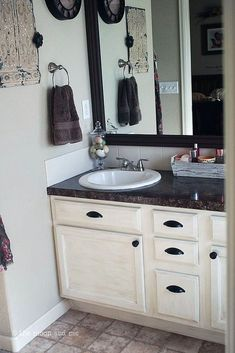 bathroom redo master mini makeover budget, bathroom ideas, home decor Bathroom Makeovers On A Budget, Budget Bathroom Remodel, Bathroom Vanity Makeover, Bathroom Vanity Lighting, Bath Remodel, Luxury Vinyl Tile Flooring, Bathroom Flooring, Brown Bathroom, Master Bathroom