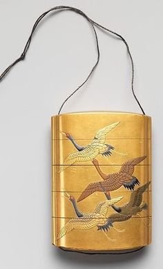 Case (Inrō) with Design of Seven Cranes in Flight. Edo period (1615–1868) Date:18th–19th century. Japan. Lacquer, fundame, gold, silver, black and red hiramakie, gold foil; Interior: nashiji and fundame. The Met.