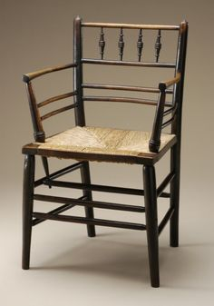 'Sussex' armchair (circa 1875-1900). Ebonized wood and rush seating by Morris & Co. (England, London and Merton Abbey, 1861-1940), Image and text courtesy LACMA. Decorative Arts and Design