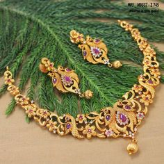 Beautiful necklace with dancing peacock design. Necklace studded with pink and white color stones. 23 September 2017.