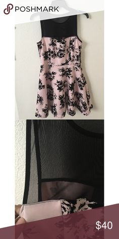 ✨PINK MESH ROSE DRESS✨ It's a pastel pink dress with a black velvet material roses. The collar bone area and shoulders are a black see through mesh top. The dress for me is above my knees slightly i'm 5'1. It's super cute but i don't wear dresses that often i've worn this once to a school dance and the chest part for me was kinda lost i should've gotten a size smaller but whatever. 10/10 condition Trixxi Dresses Prom