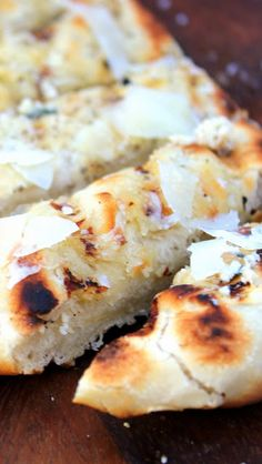 Grilling Time - GRILLED Flat Bread with Sea Salt, Pepper and Parmesan Cheese... This is FAST FAST FAST anf EASY EASY EASY and has a dramatic unique look, taste and crowd pleasing aspect as you are making grilled flatbread... CRACKERS.  These are great to serve along side a summer salad.