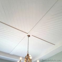 DIY Plank Ceiling in a Beautiful White Kitchen Renovation beautiful diagonal planked shiplap ceiling design via Remodelaholic Shiplap Ceiling, Porch Ceiling, Plank Ceiling, Home Ceiling, Ceiling Panels, Ceiling Decor, Living Room Ceiling Ideas, Bead Board Ceiling, Shiplap Trim