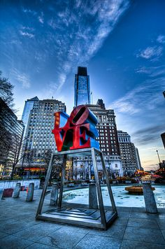 Take a picture near this infamous sculpture in Love Park (Philadelphia, Pennsylvania).