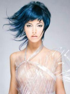 Teal blue hair with shag haircut