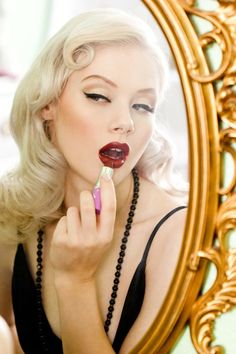 (inspiration)  hot lips , black eyeliner, pin-curl.  theme color neutral (white), black and red