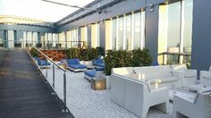 Novotel Barcelona City: Top of the roof with swimming pool,  bar,  and fitness amenities.  A gem!