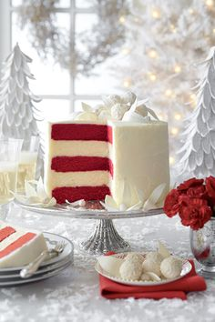 Red Velvet-White Chocolate Cheesecake - Showstopping Christmas Cake Recipes - Southernliving. Recipe:Red Velvet-White Chocolate Cheesecake  Whimsy meets elegance in all five layers of this red velvet-white chocolate wonder.  Watch:Assembling Our White Layer Cake