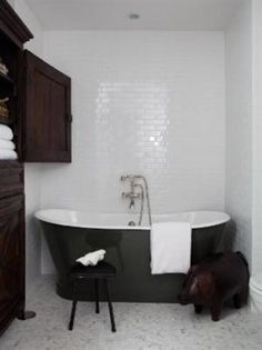 Master Bathroom Designed by Nate Berkus. A custom English Tub & white subway tiles lend a classic look to the master bathroom. #bathroom - AND A PIG!