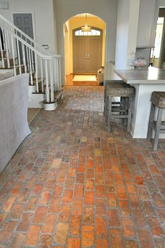 love the brick on the kitchen floor