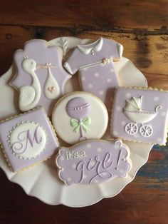 """Sugar """"It's a Girl"""" Baby Cookies with Royal Icing Designs of Stork, Baby Rattles, Monogram and Carriage."""