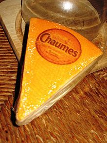 Chaunes, acow's milk cheese from Périgord South West of France. Characterized by a unique, full-bodied flavor, Genuine Chaumes is coming from the washed rind family. It has a delightfully soft, springy texture and is rich and creamy with a fully edible paper-thin rind. Hailing from the fertile meadows of the Dordogne region of France, it is a modern French classic. Excellent on crusty French bread or melted over potatoes.