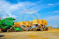 Modern harvester combine and trucks during harvest time at Paddy field near Sekinchang Malaysia.