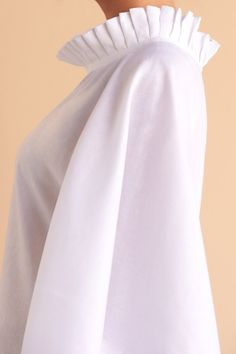 One style, two ways. This divine white linen pleated short kaftan gives you the option to wear as a dress or top. Fácil Blanco is proudly designed and tailored in Dubai from Italian linen. Female Pirate Costume, Pirate Costumes, Felt Baby Shoes, White Kaftan, African Blouses, Designs For Dresses, Gypsy Skirt, White Dress Summer, Renaissance Clothing