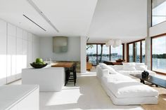 Colombian-born designer Catalina Echavarria wanted to create 'hang-out space' drenched in white for her family's home in Coconut Grove, Fla. A look at the costs.