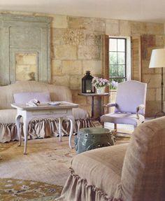 Pamela Pierce on French Style | Maison & Co. ~ We love the blue painted trumeau and linen slipcovered furniture!  Photo via Veranda Magazine.