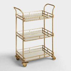 Maybe I can use this cart for my 'spa' bar| One of my favorite discoveries at WorldMarket.com: Gold Cole 3-Tier Rolling Bar…