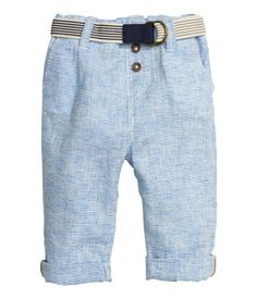 Pants in woven fabric made from a cotton and linen blend. Adjustable elasticized waistband, elasticized belt, and mock fly with buttons. Side pockets and mock back pocket with flap.