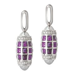 The Byblos amethyst and diamond earrings by Avakian are inspired by the architecture of Byblos, the ancient Phoenician city that today forms part of Lebanon. They are set with 2.75 carats of amethysts and clusters of diamonds at each end, spin round with the slightest touch. Discover the jewellery house from Geneva give fashion a playful spin: http://www.thejewelleryeditor.com/jewellery/top-5/top-5-avakian-jewels-you-need-to-see-to-believe/ #jewelry
