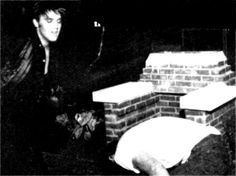 Elvis in Memphis in june 1956 in the backyard of his home boxing with Red West.