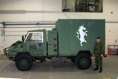 Item 94, GISHWHES 2012 , Team Badwolf- Unicorn painted on military transport