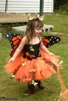 Tiffiany: Tulle (orange, black and yellow), Sequins (orange), Glitter (orange and black), Clear School Glue, Hangers, Fabric (orange and black cotton) Feather Monarch Butterflies, Barrette, Crocheted Headband Material I made an...