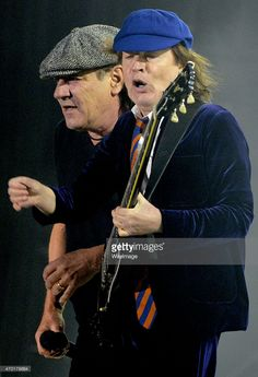 Brian Johnson (L) and Angus Young of AC/DC perform during the 2015 Coachella Valley Music And Arts Festival at The Empire Polo Club on April 17, 2015 in Indio, California.