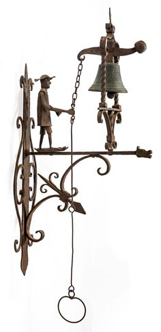 An antique Italian-forged iron doorbell.