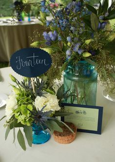 Simple, pretty, wild table centerpieces with random vases/containers