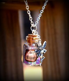 all you need is faith and trust...and a little fairy dust! Perfect fairy dust bottle necklace WITH fairy attached!