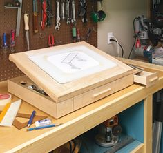 Sketch out your next project on a smooth glass surface that tilts to a comfortable angle. Two drawers corral all your drawing supplies. Woodworking Projects Diy, Woodworking Furniture, Woodworking Tools, Furniture Projects, Wood Projects, Woodsmith Plans, Router Lift, Drill Press Table, Desk Plans
