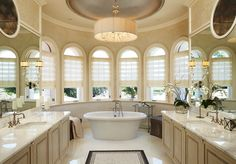 the-extraordinary-bathroom-ideas-with-royal-master-bathroom-decoration-big-bathtub-bathroom-cabinet-marble-countertops-sinks-steel-faucets-round-chandelier-unique-windows-oval-mirror.jpg (1280×890)
