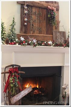 rustic christmas mantel.  Love the sled being by the fireplace