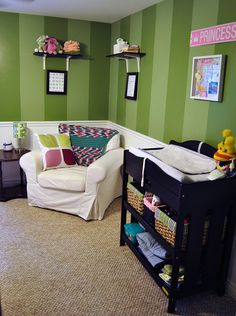 Green and pink gender neutral nursery turned into a girl nursery. Green stripes