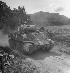 U.S. M4 Sherman tank during the Invasion of Saipan, June - July, 1944.
