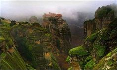 """Meteora is a monastery complex in Kalabaka, Greece, perched on rock pillars, once accessible only by frayed ropes. The name Meteora means """"suspended in the air"""" or """"suspended rocks"""" and it is. Zhangjiajie, Places In Greece, Les Cascades, Beautiful Places In The World, Heritage Site, Prague, Beautiful Landscapes, Wonders Of The World, Places To Go"""