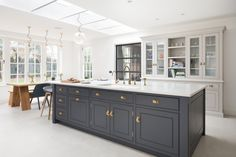 This kitchen island acts as the main prep area in this project and has been finished in H Open Plan Kitchen Living Room, New Kitchen, Kitchen Decor, Kitchen Dining, Blue Kitchen Cabinets, Refacing Kitchen Cabinets, Kitchen Island, Cabinet Refacing, Plain English Kitchen