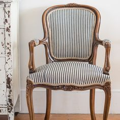 Here's a closer look at the french chair next to the chippy buffet. It was upholstered in antique ticking with a sagless, tight-weave burlap on the back. #upholstery #furnituremakeovers #furniture #mmsstudio #frenchchair #ticking