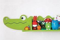 Tres cuartos originales para chicos  El estante con forma de cocodrilo fue comprado en una feria.  /Magalí Saberian