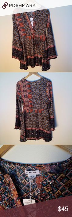 Urban Outfitters Deep V Neck Bell Sleeve Dress Super cute size small Urban Outfitters Dress! Brand new with tags. 100% polyester. Deep V neck that ties up. Bell sleeves. Paisley pattern. Perfect for spring! Urban Outfitters Dresses