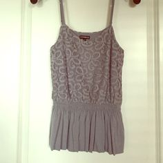 Express Gray Top Elastic waist band makes for an adorable fit of this cute top! Not quite a crop top but definitely fits shorter. Perfect for summer! Express Tops Tank Tops