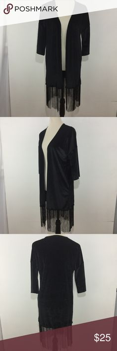 Velvet Mid Length Kimono with Fringe in Black On Trend - Black Velvet Mid Length Kimono with Black Fringe - 3/4 Length Sleeve  Size: Small  Color: Black Brand: Say What ? Style: Kimono Material:95% Polyester / 5% Spandex  Condition: New with Tags / No Visible Flaws    black velvet mid length long fringe kimono 3/4 length sleeve Say What? Jackets & Coats