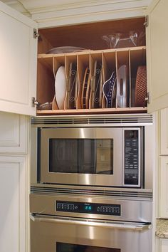 Efficient use of space above oven/microwave to store long narrow items like trays and cookie sheets The dividers keep it from becoming a jumbled mess