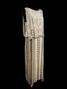 "Beaded silk crepe/satin evening dress, c.1920. Label: Frances & Co. Dressmakers, Inc./10 West 56th St./New York."""