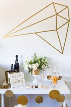 main table from a black white gold geometric bridal shower via karas party ideas