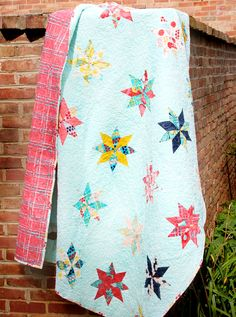 http://lauragunn.typepad.com/   Love this quilt and her fabric