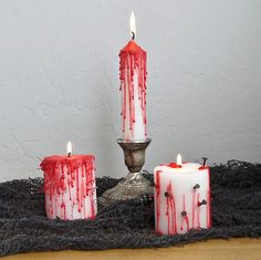 Oh the Gore! DIY Bleeding Halloween Candles: Transform dollar store candles into bleeding votives that really set the tone for an eerie evening of Halloween fun.