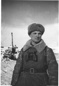 "Well padded Russian officer, carrying a pair of ""requisitioned"" German standard issue Zeiss field glasses,in the vicinity of Stalingrad after the end of the battle in Jan 1943. The Russian winter kit was a significant factor in Red Army endurance in contrast to the rather pitiful state of German extreme cold clothing."