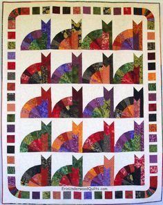 Inner Cat quilt pattern by Erin Underwood Quilts.  Made with a 15-degree ruler.